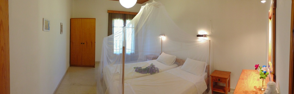 Bedroom with mosquito net panoramic